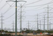 Power lines are shown as California consumers prepare for more possible outages following weekend outages to reduce system strain during a brutal heat wave amid the outbreak of coronavirus disease (COVID-19) in Carlsbad, California, U.S., August 17, 2020. REUTERS/Mike Blake